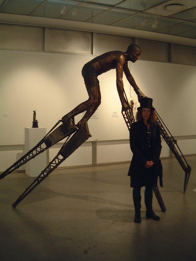 Elizabeth Balcomb standing next to 'Son of Man, 2015' (3)